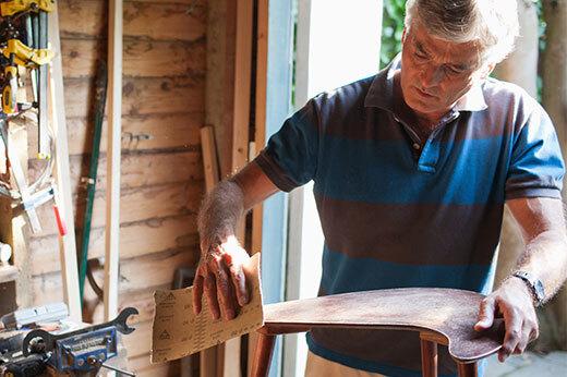 Man working on wood furniture